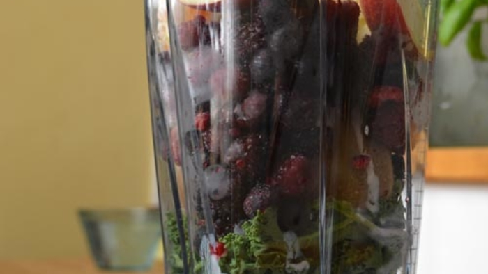 Blender full of fruits and vegetables